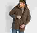 The bomber part of the Arctic 3 In 1 Parka is shown on a tall, brown-haired model.