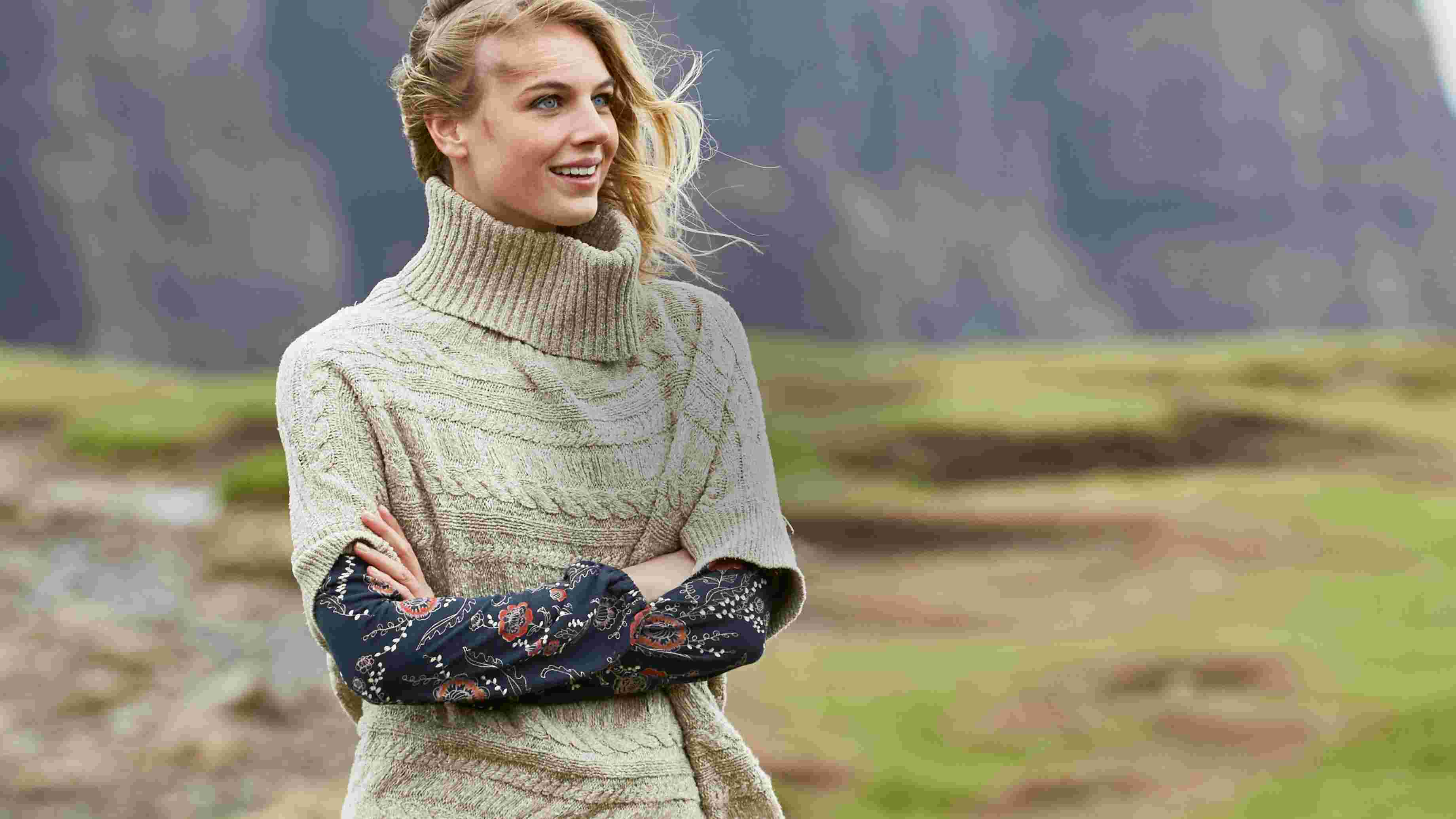 video of FatFace women's cable poncho