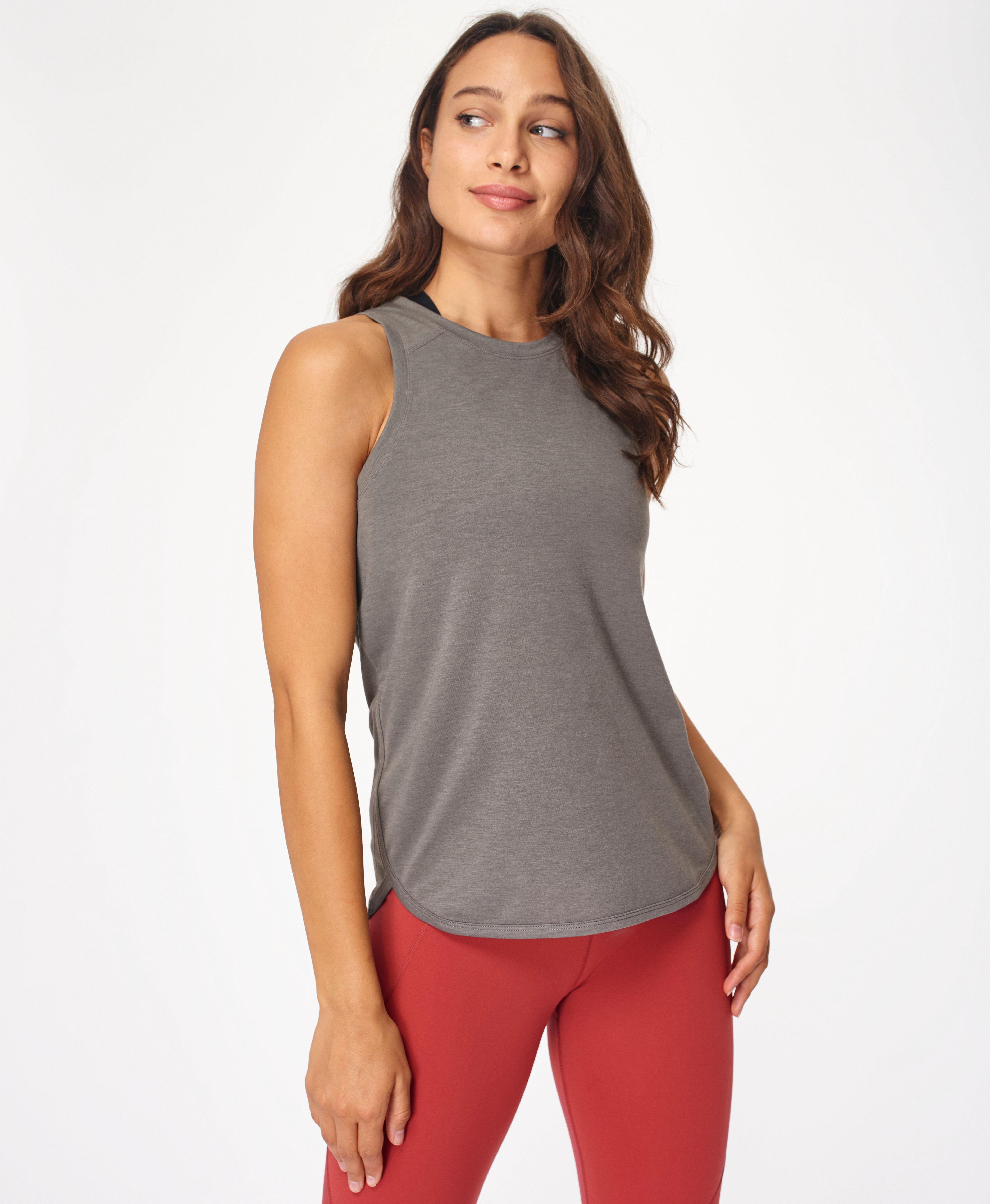 Embrace your sweaty workouts in the loose fitting tank made for high-intensity workouts. In sweat-wicking and quick drying fabric, this is perfect for layering with a dropped hem and wide straps that cover your sports bra.