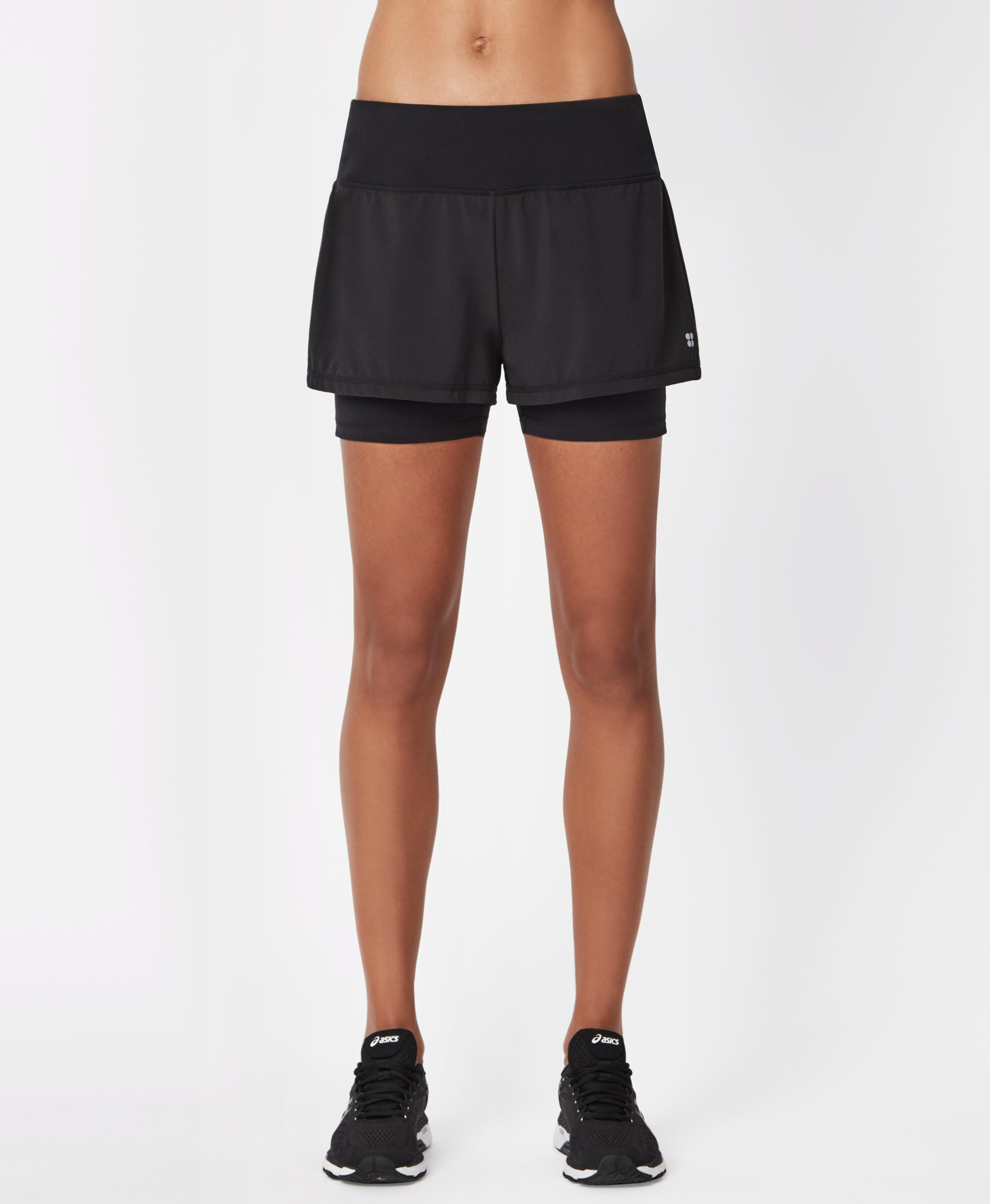 Looking for the perfect running shorts? We\\\'ve got you with these lightweight, sweat-wicking shorts with a supportive inner short for extra coverage and wide wasitband with adjustable drawcord.