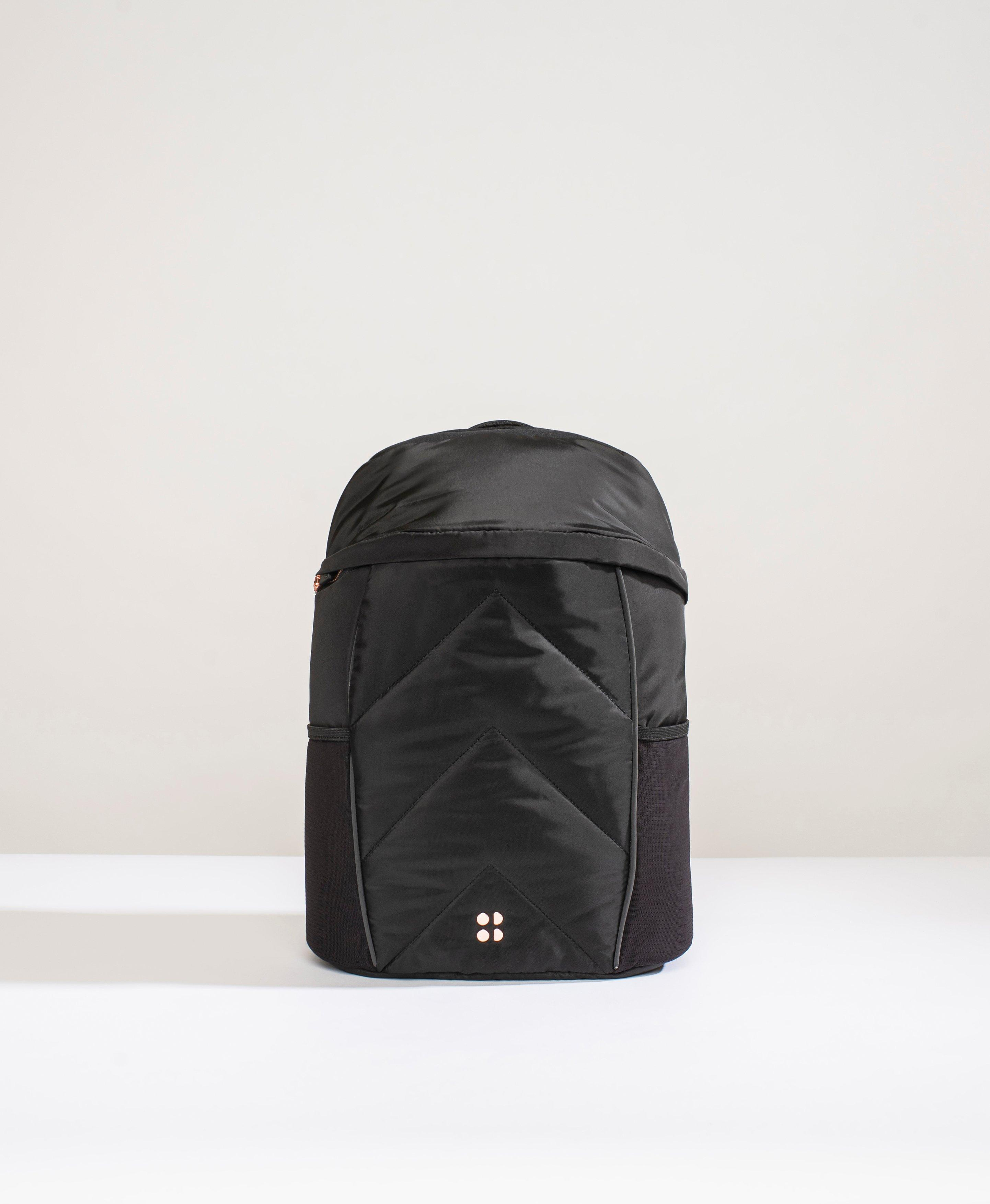 A running backpack that ticks all the boxes. In a sleek, lightweight design, this features adjustable padded shoulder straps and a secure chest and hip strap. Stay hydrated on the go with the inbuilt hydration pocket and keep everything in place with multiple internal and external compartments including a dry pocket, invisible pocket and mesh water bottle holders.