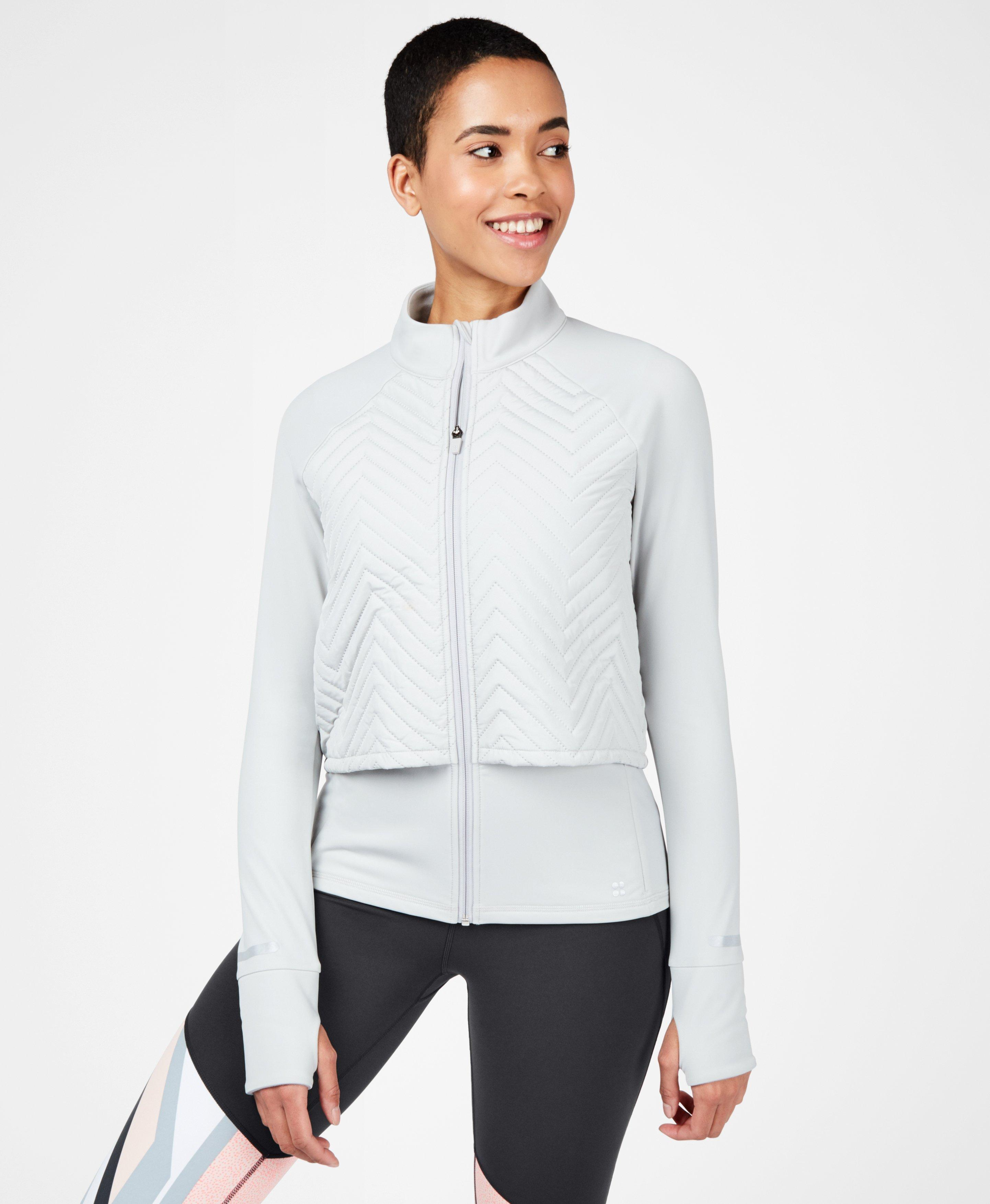 Our famous Fast Track Running Jacket just got even better with lightweight thermal padding and a water resistant finish. Ideal for winter workouts, the breathable fabric will keep you warm AND dry as you run and train outdoors. With a long back hem that covers the bum for running and cycling.