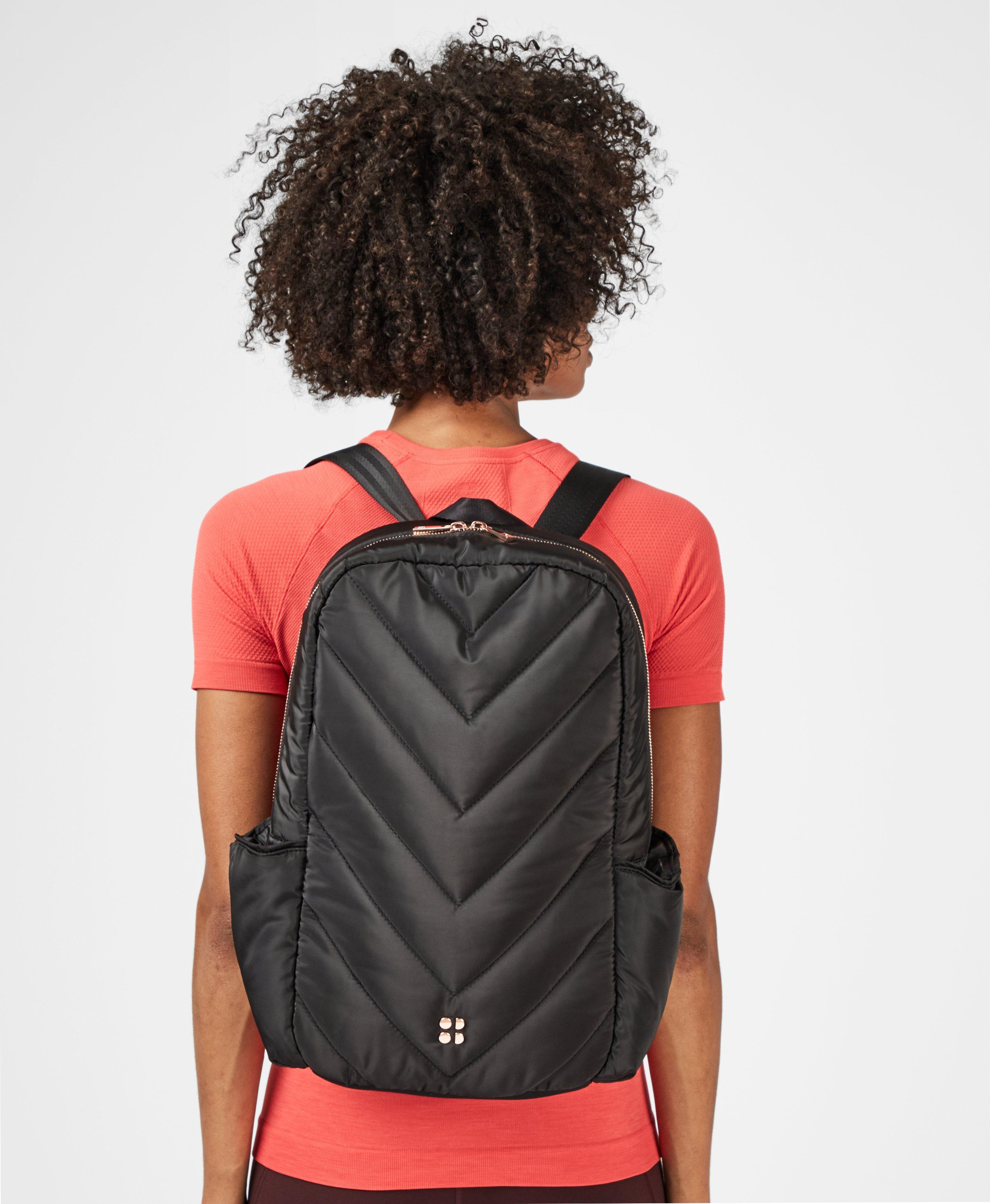 A sleek new update to the runners favourite backpack. Designed in super lightweight breathable fabric for comfort on the go, with adjustable padded shoulder straps, reflective panels and a secure chest and hip strap. With 6x compartments including a zip inner pocket, you can fit a laptop inside and your water bottle in the outside pocket. Hello dream commute.