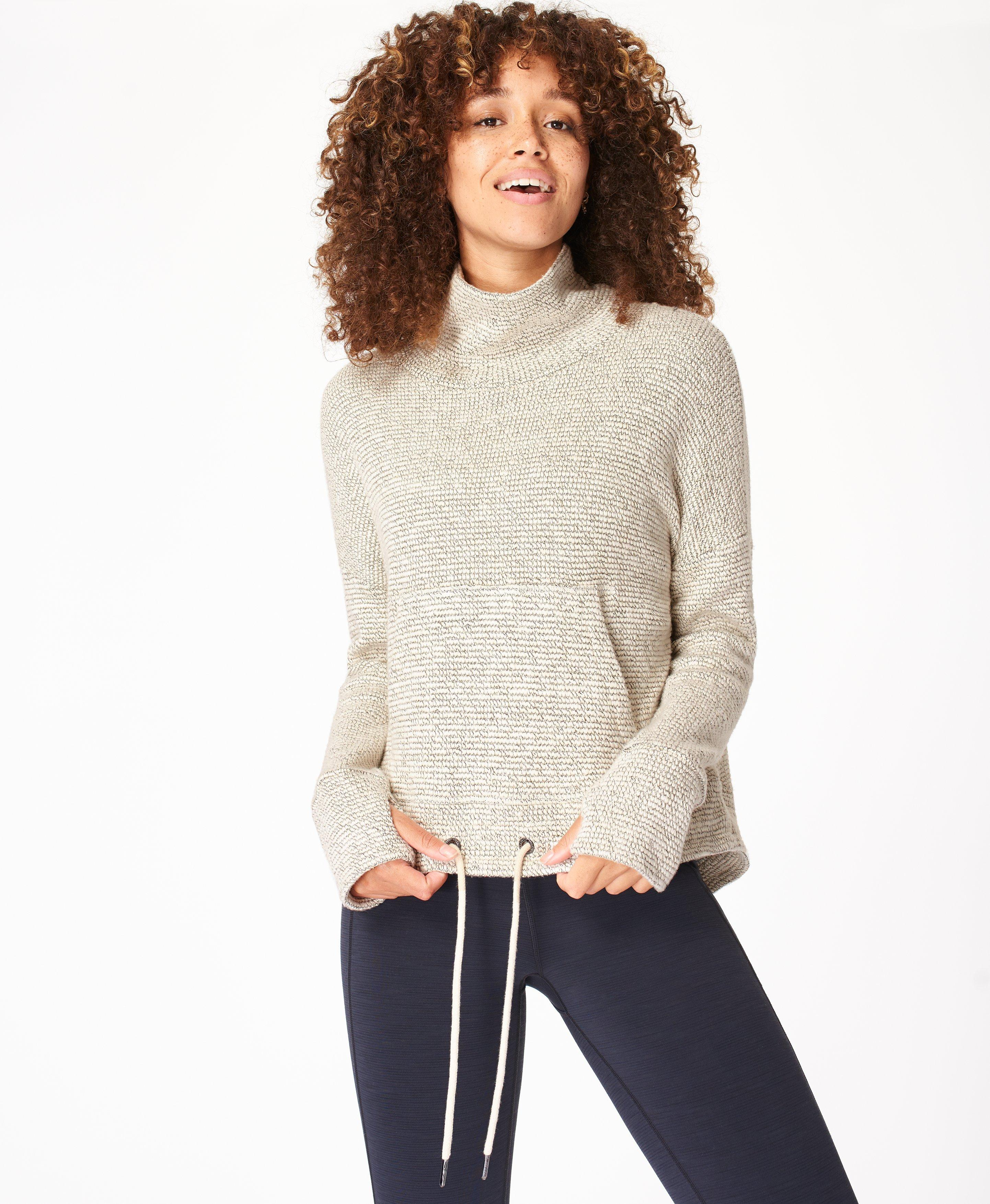 Style it up post-workout or to go out for brunch in this boucle sweatshirt, with a high neck and relaxed slouchy fit. With a front pocket, dropped back hem made for layering and a tie up front.