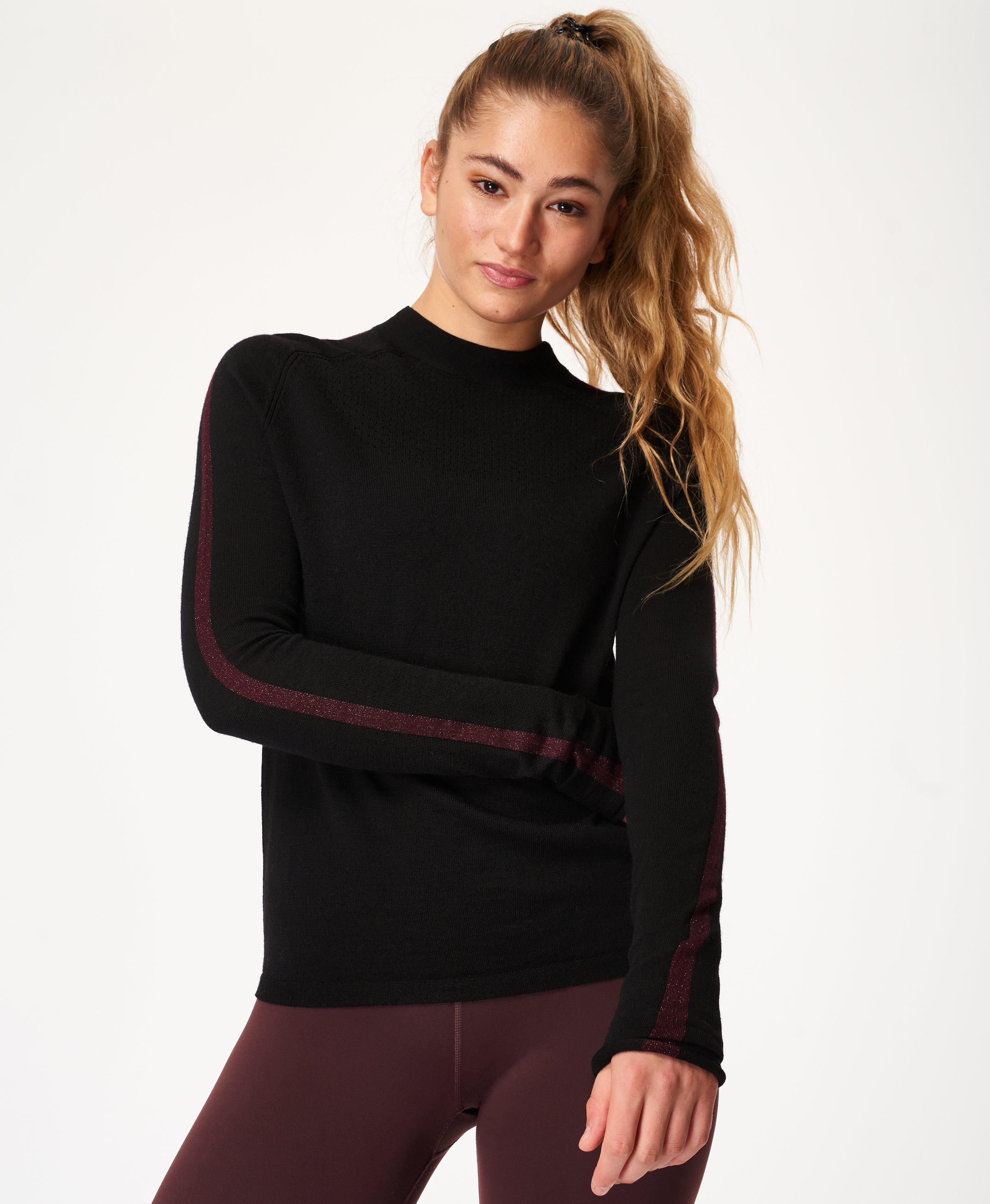 Meet the high performance knit you can run or relax in. Made from 100% merino wool, this temperature-regulating hero fabric keeps you cool when youre warm and warm when youre cold. In a slim fit, this features a high neck, a contrast stripe and punched holes for breathability.