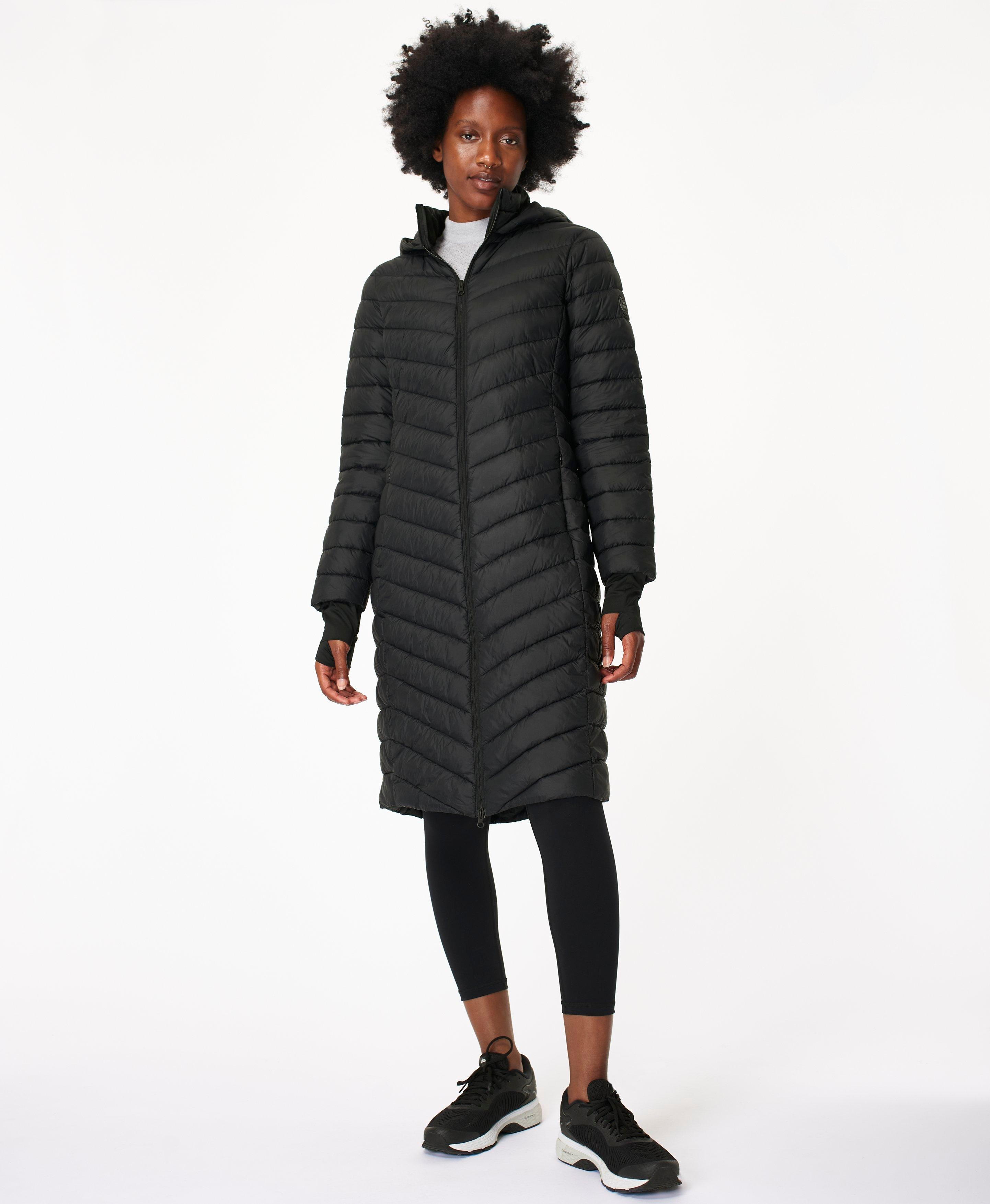 Enjoy warmth without weight with this ultra-lightweight puffa jacket. This quilted style is water resistant, has a slim fit and falls to just below your knees. A cozy hood, zip pockets and a double ended front zip complete this all round favorite.