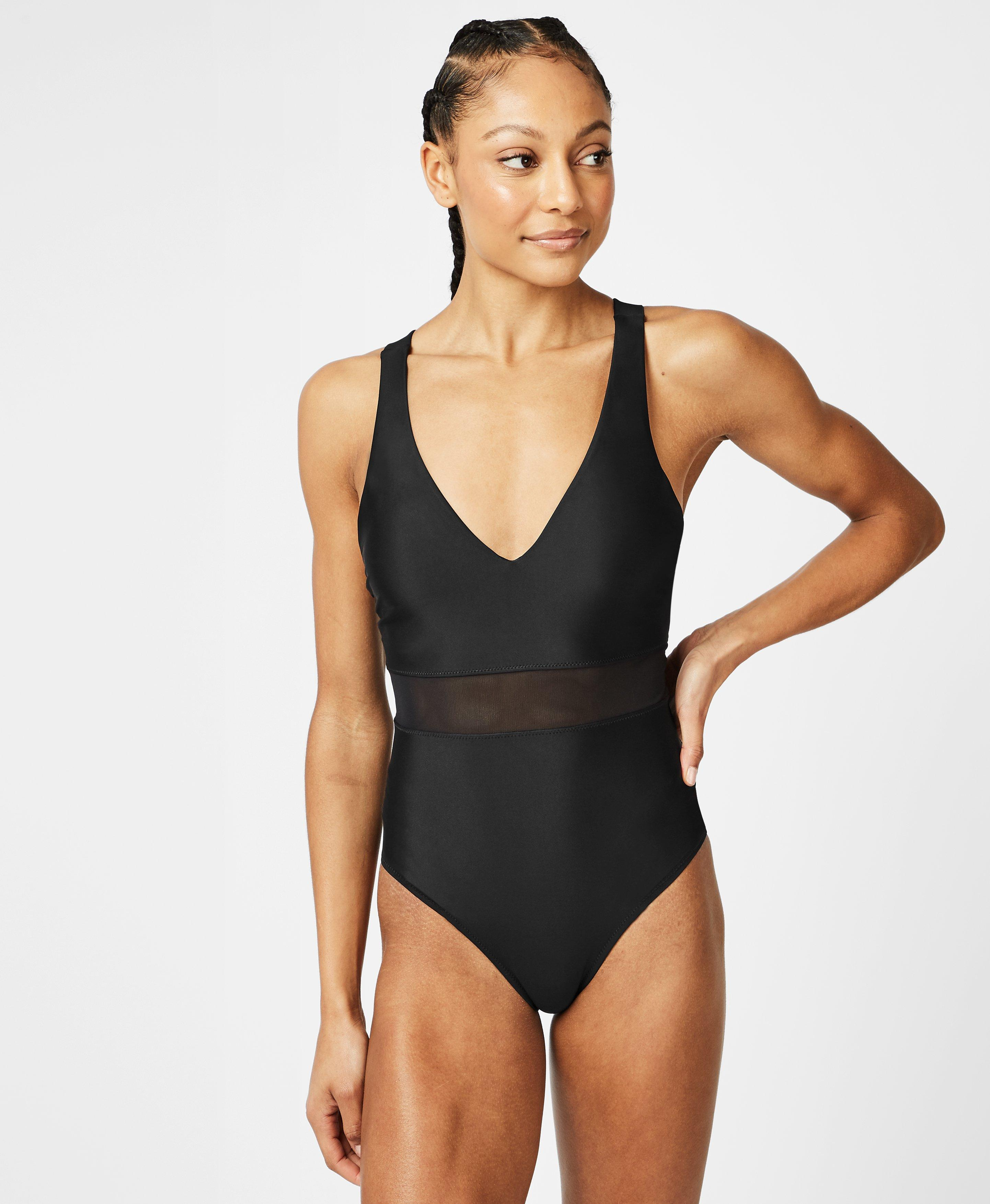 Statement one piece made from ECONYL & reg regenerated nylon produced entirely from recovered fishnets and other nylon waste. A sleek beach style with a flattering nipped in waist with mesh panels and low V neck.