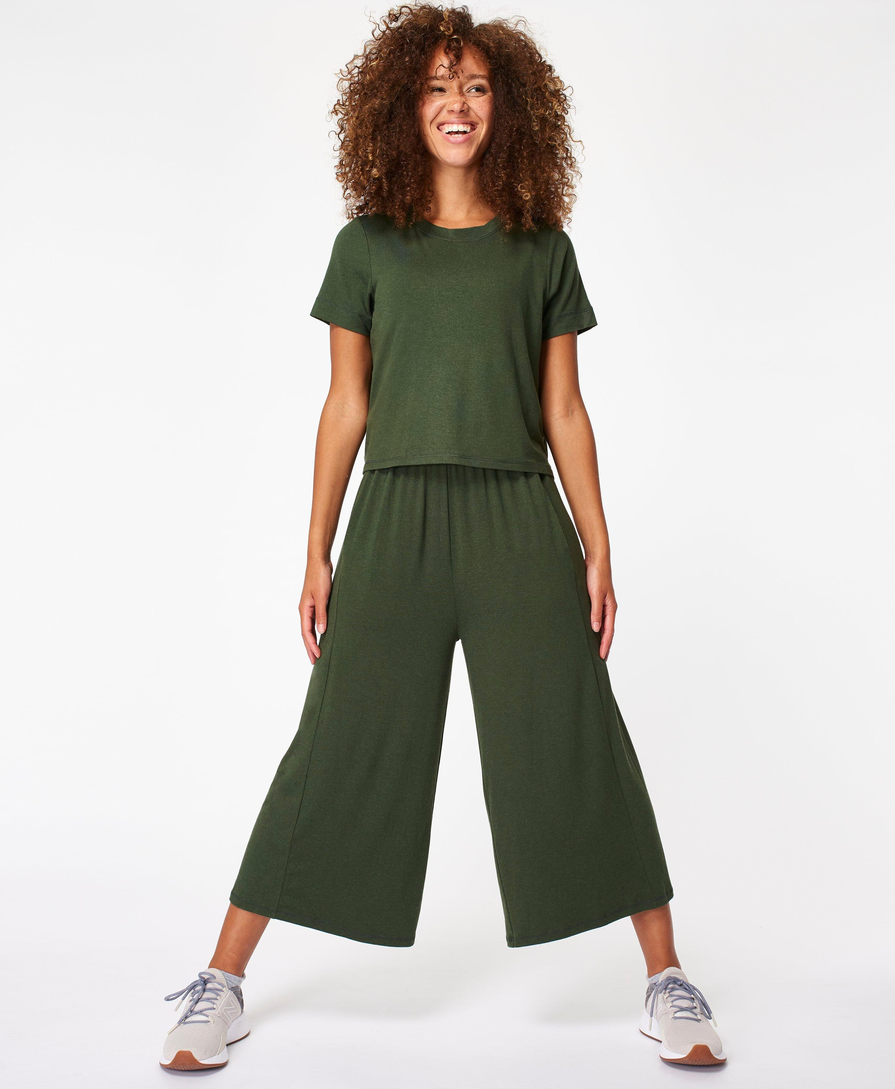 In our signature super soft jersey with the perfect drape, this easy wear jumpsuit has a short sleeved relaxed fit over layer tee with open back and culotte length wide legs. Perfect for picnics or chilling at home.