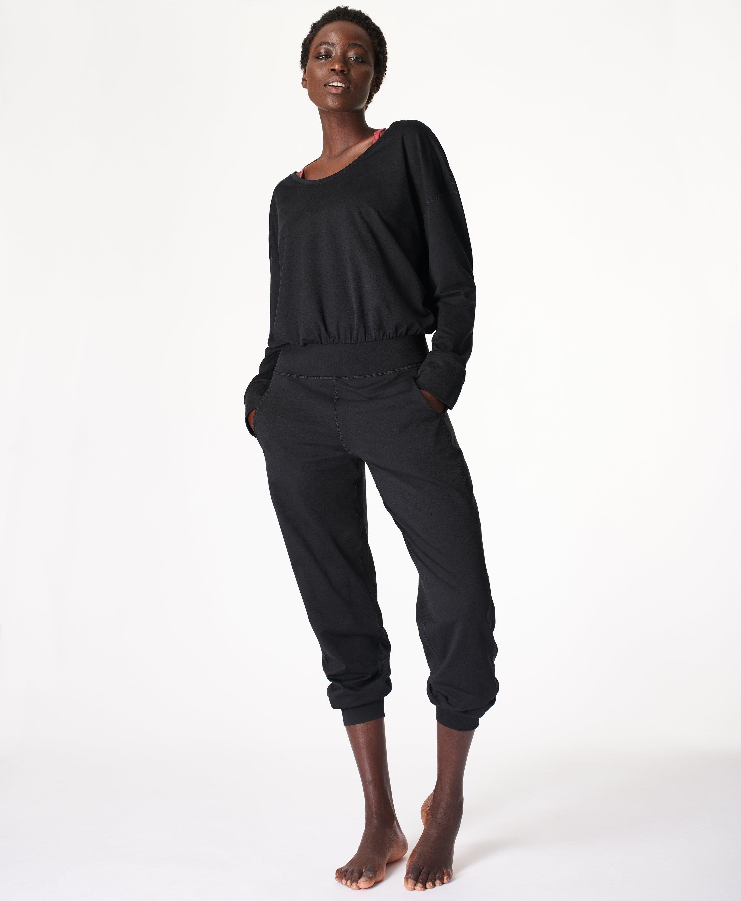 Everyone\\\'s favorite Gary Jumpsuit, now with long sleeves for cooler days. In our famous hero fabric, this is lightweight, soft as a cloud with a flattering scoop neck, flat fitted waistband and relaxed fitting pants with fitted cuffs. Wear for yoga, Pilates or pyjama level comfort.