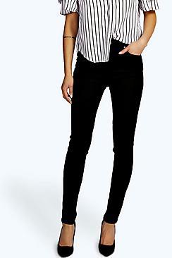 Jeans a tubo super aderente a vita alta