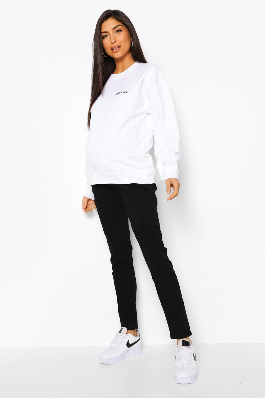 Узкие джинсы поверх живота для беременных фото