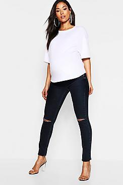 Jeans premaman a vita bassa con tagli sul ginocchio
