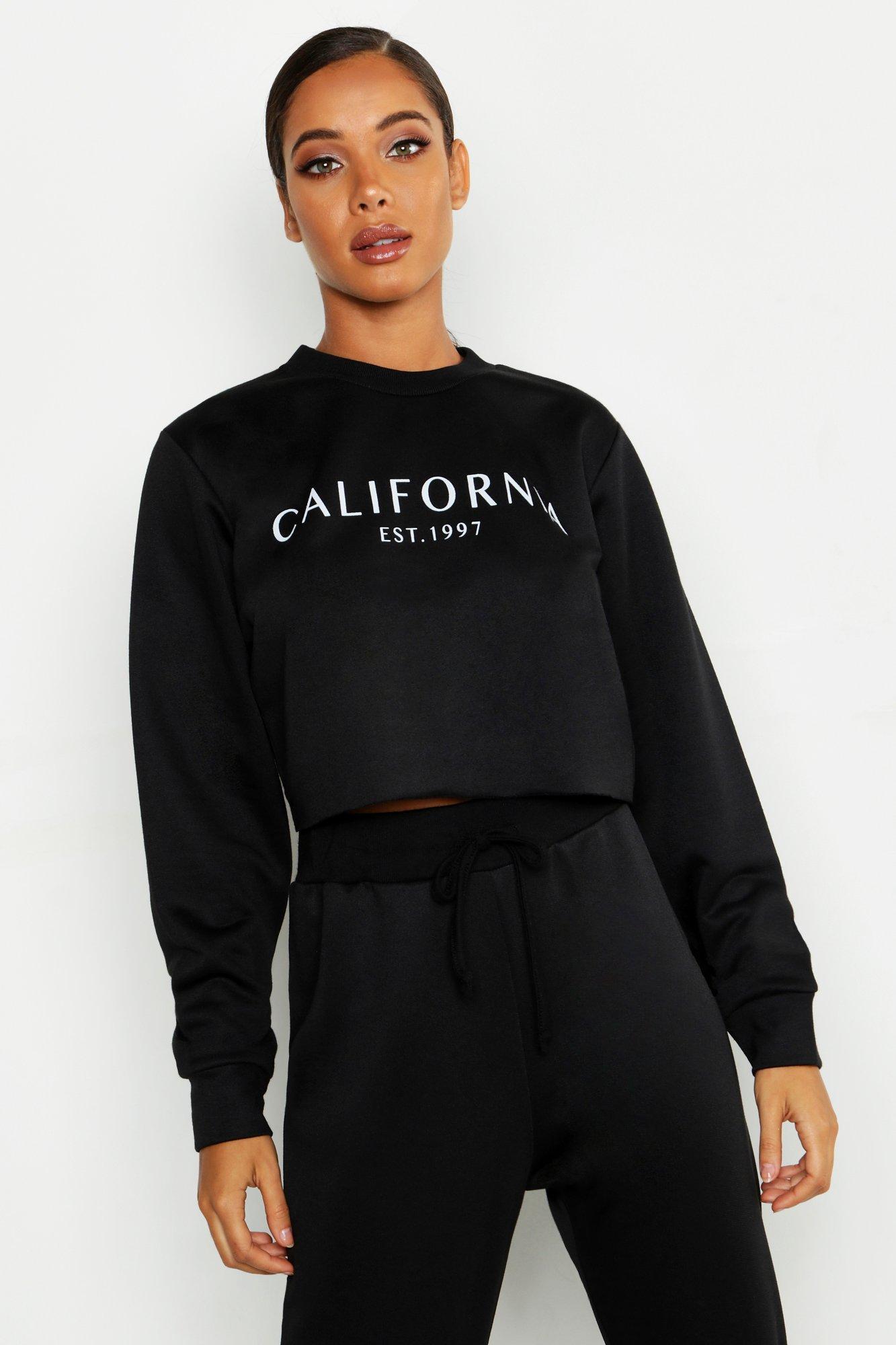 Womens Kurzes Sweatshirt mit Rundhalsausschnitt und California Slogan - schwarz - 36, Schwarz - Boohoo.com