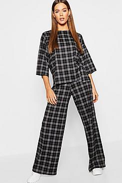 Coordinato con t-shirt oversize a quadri con spacco + pantaloni