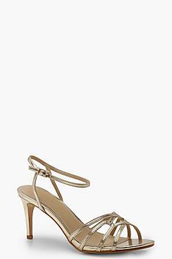 Scarpe con tacchetto metallizzato e laccetti incrociati