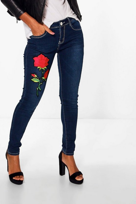 Zoya Mid Rise Floral Applique Skinny Jeans