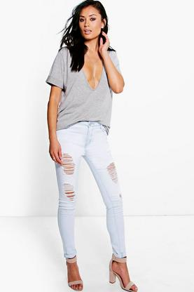 Frankie Mid Rise Bleach Distressed Skinny Jeans