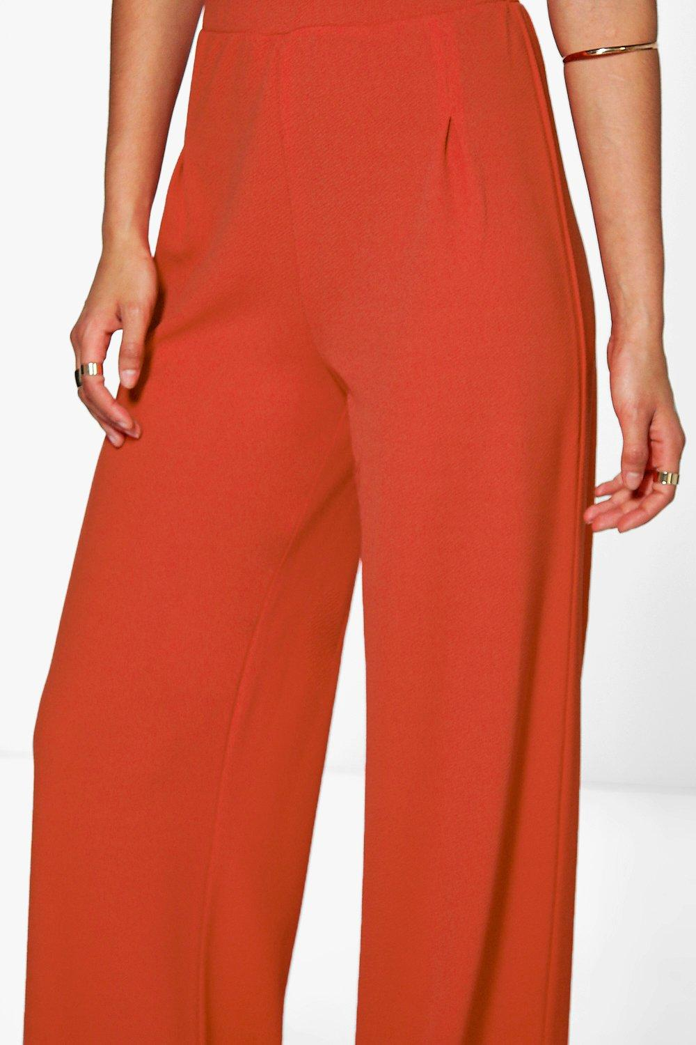These % Polyester ladies pleated pants are available in black with pockets in the front and one in the back. While fastened with a brass-zippered hook and eye closure, the rubberized waistband allows for 2 inch expansion.