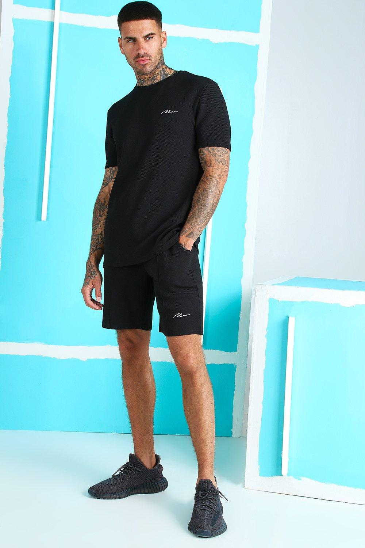 Фирменный сет MAN: футболка из жаккарда и шорты с защипами фото