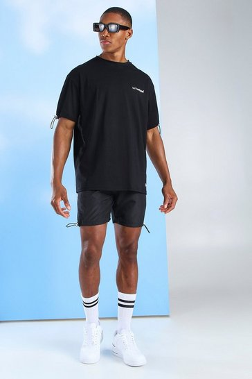 Black MAN Official T-Shirt & Nylon Short Set