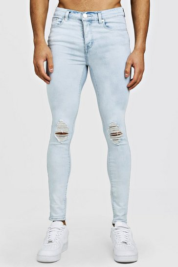 Ice Spray On Skinny Jeans With Ripped Knee
