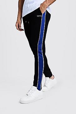 Pantaloni jogging a pinocchietto con pannelli laterali con marchio MAN