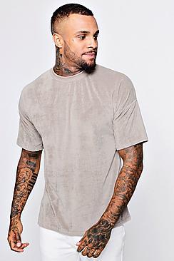 Completo maglietta in velour con spalle abbassate e pantaloncini