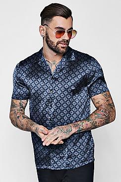 Camicia a maniche corte blu oltremare con revere e stampa foglie