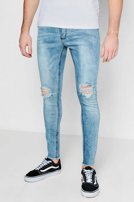 Spray On Skinny Jeans With Ripped Knee