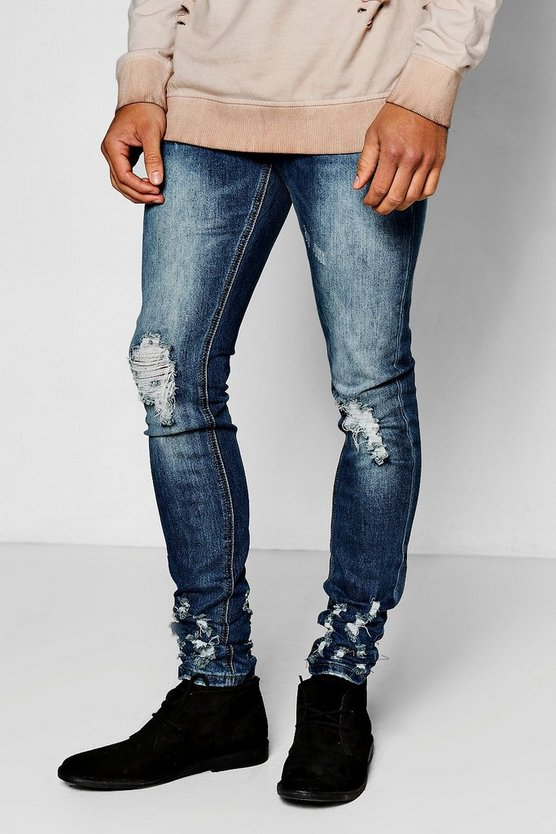 Mid Blue Ripped Knee Skinny Jeans