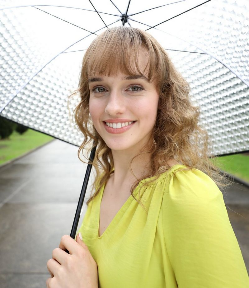 Posed portrait with umbrella