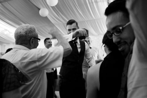 Behind the scenes at Romanian wedding - Groom Dancing B&W Image - taken with a EOS 5D Mark IV