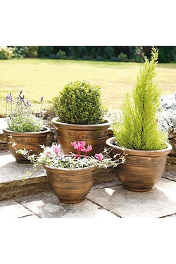 Set Of 4 Antique Look Planters