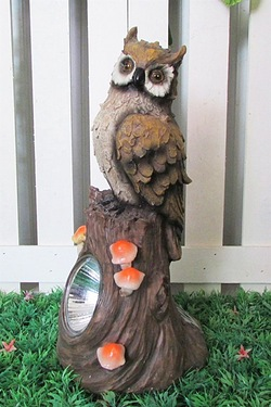Solar Owl On Trunk