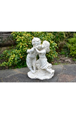 Girl Kissing Boy Statue