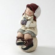 Ceramic Girl With Bird Figurine