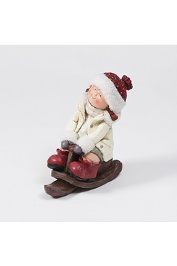 Ceramic Girl On Sleigh Figurine