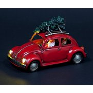 Santa Driving Vintage Beetle Car