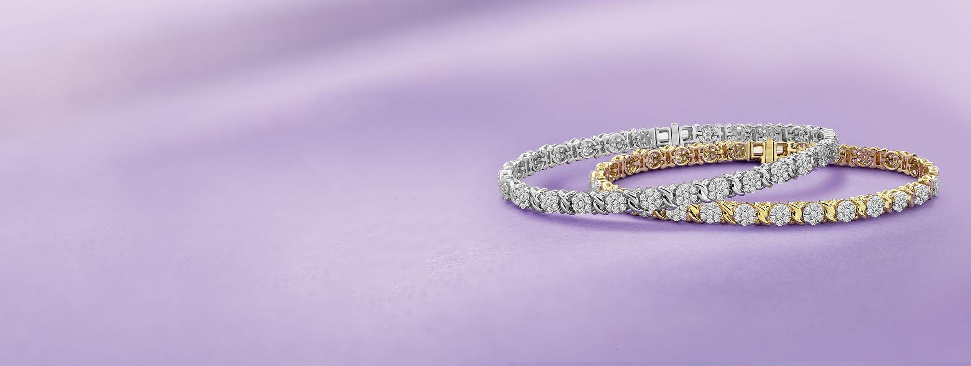 Keep the ones you cherish close to your heart this Christmas with The Classic Diamond Collection at Ernest Jones