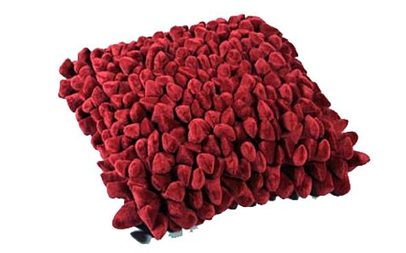 Pebble Cushion, a red and bobbly cushion