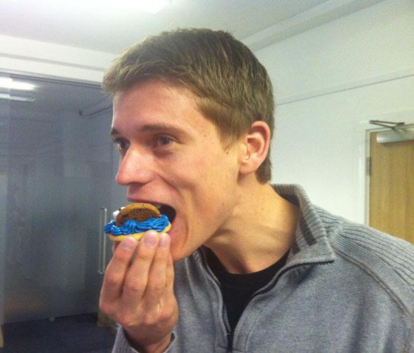A man eating cookie monster cookies