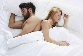couple in furniture village bed