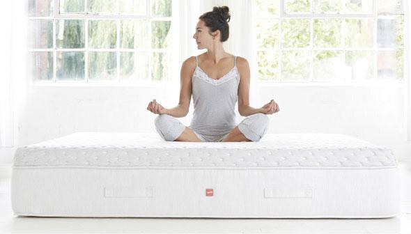 Woman sat on a mattress meditating