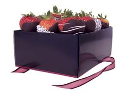 Chocolate dipped strawberries in a box