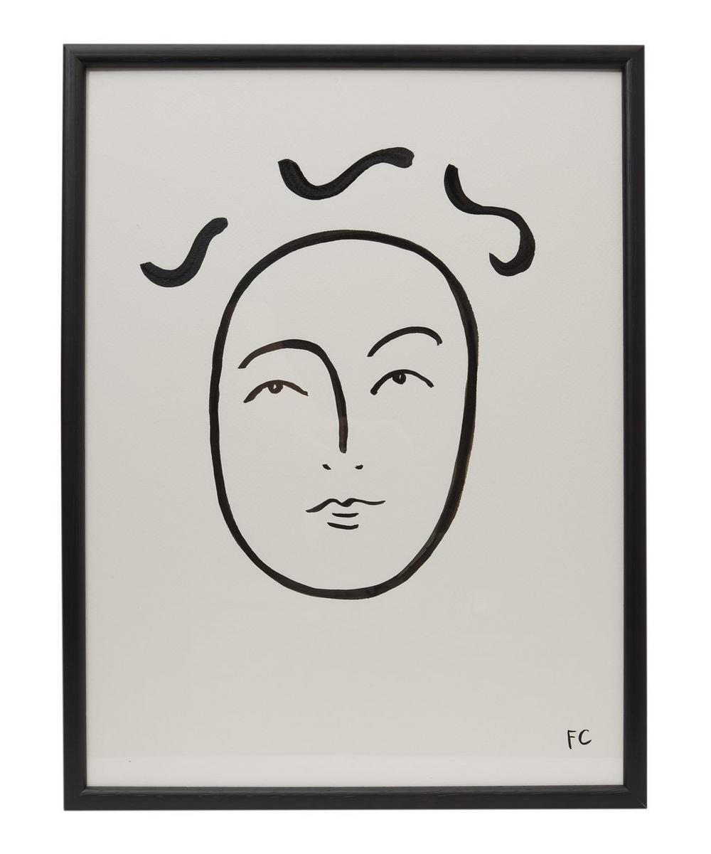 Face in Black Framed Drawing