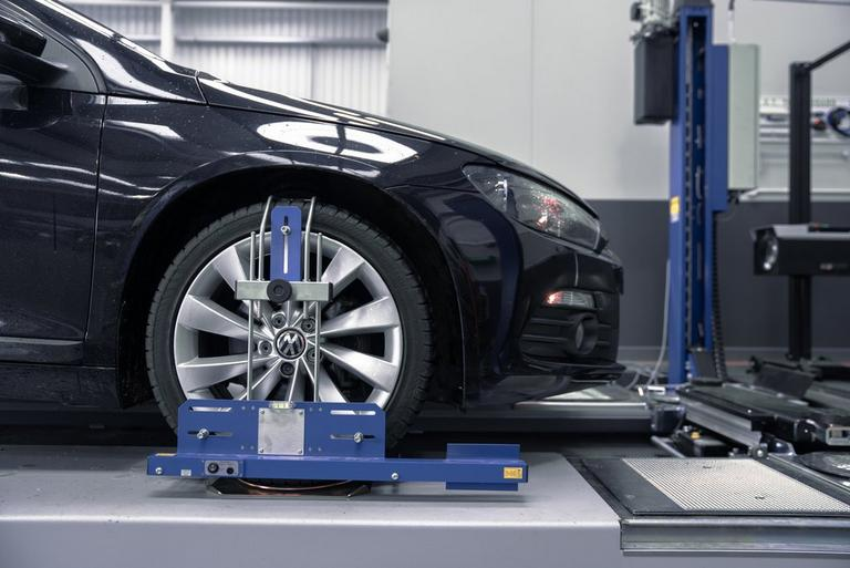 What is wheel alignment or 'tracking'?