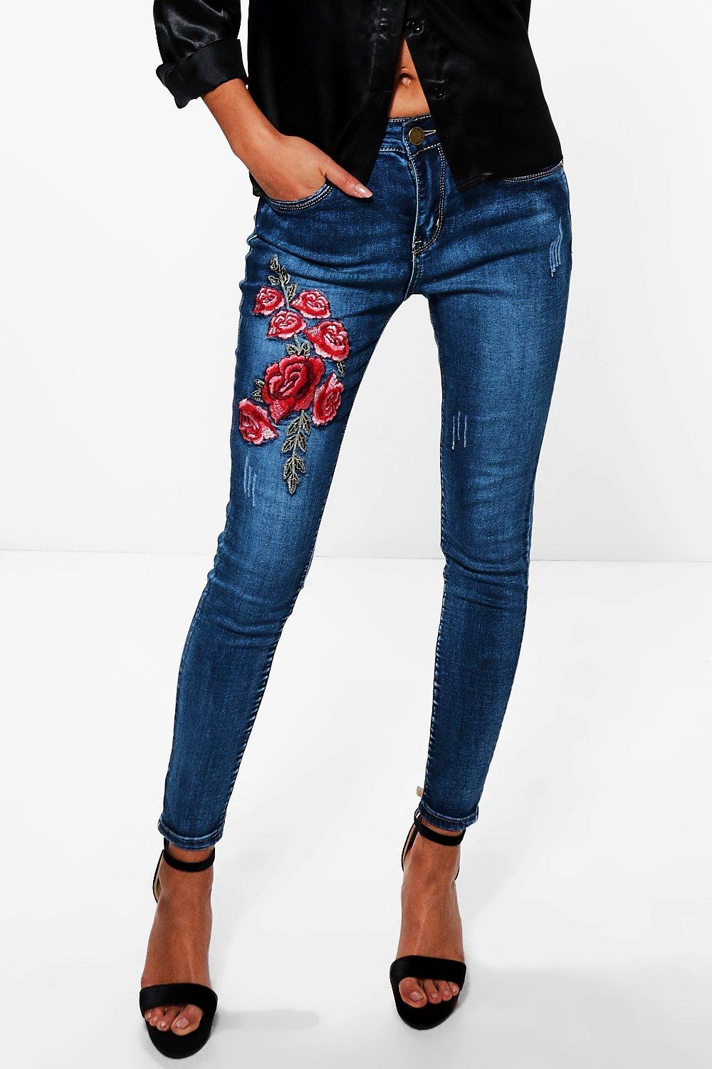 Hannah mid rise floral embroidery skinny jeans at boohoo