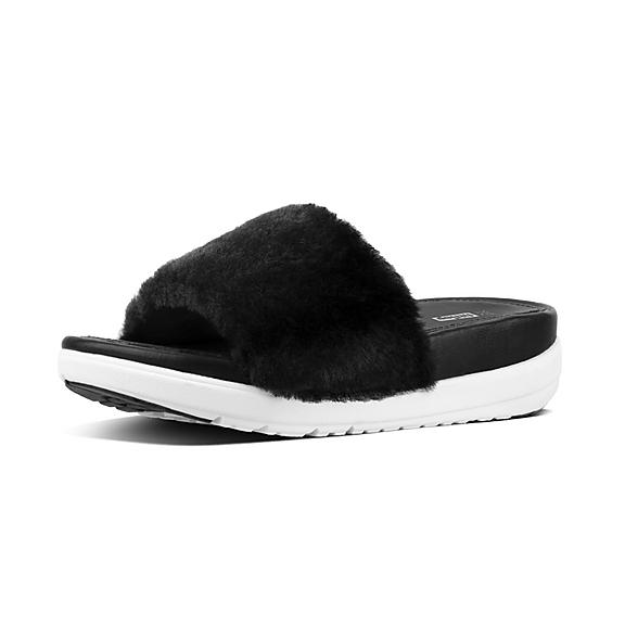 b40c1fd8136bf Shearling Leather Slides.  395.00 · LOOSH LUXE