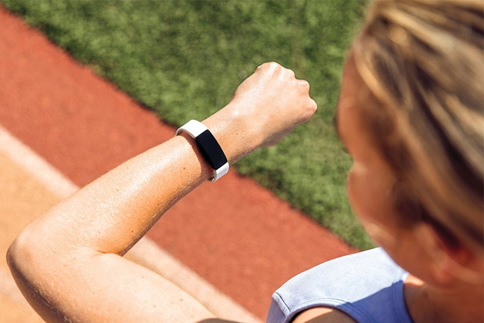 Image of a woman watching her smart watch