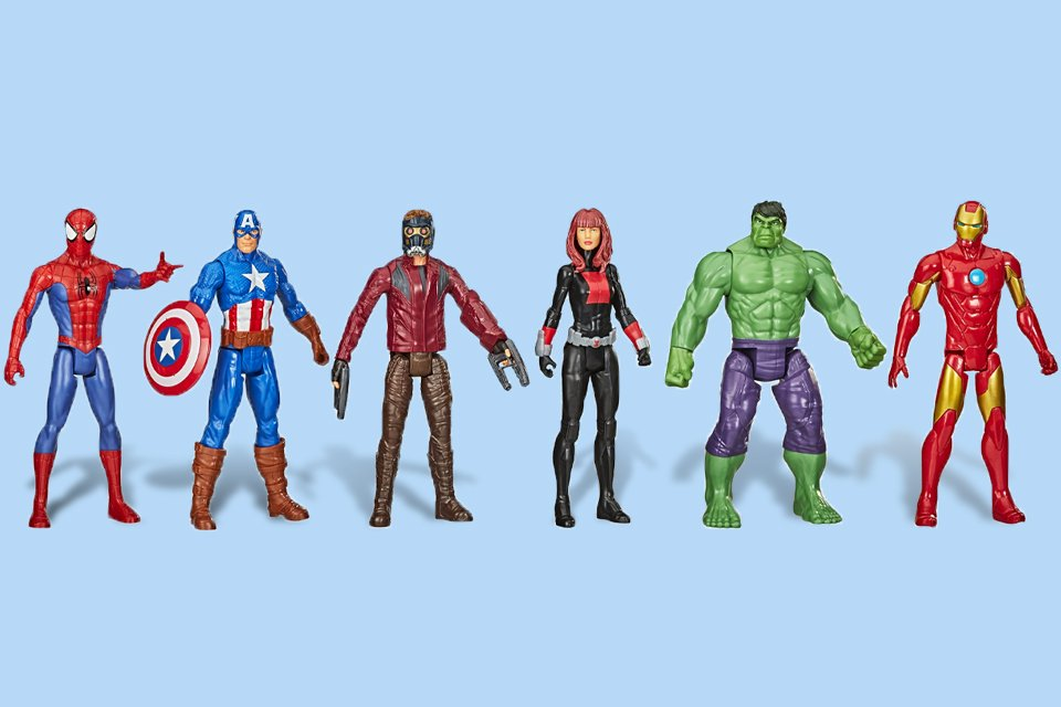 Superhero action figures standing together.